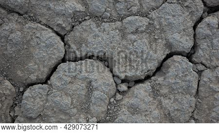 Dry Cracked Ground In Hot Season Dry Summer Global Climate Change Lost Harvest Theme. Drought In Agr