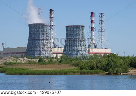 St. Petersburg, Russia - June 04, 2021: Cooling Towers On The Background Of The Building Of The City