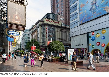 Shanghai, China - September 2019: People On Walk Street Paralleled Both Sides By Commercial Building