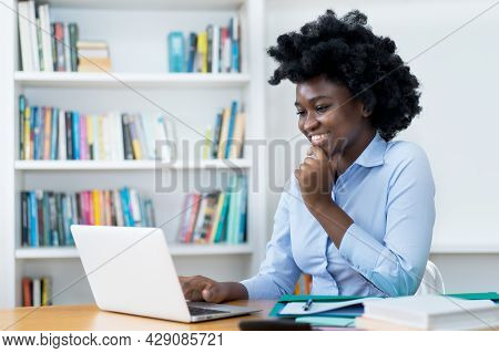 African American Student Or Business Trainee At Video Call At Desk At Office