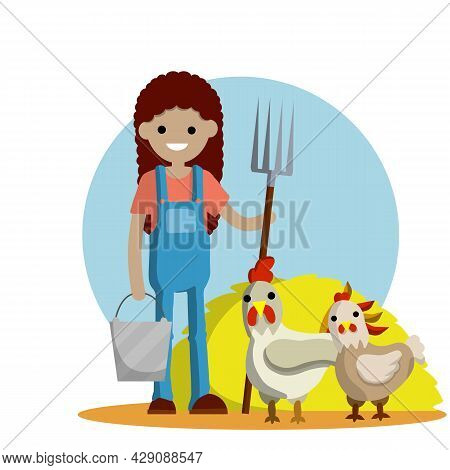 Young Woman In Blue Farmer Overalls Stands With Pitchfork