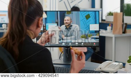Executive Manager Eating Delivery Takeaway Pizza During Online Videocall Conference Meeting Discussi