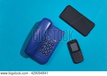 Landline, Push-button Telephone And Smartphone On Blue Background. Top View