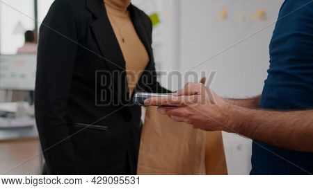 Closeup Of Businesswoman Paying Delivery Food Order With Credit Card Using Contactless Working In St