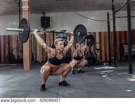 Strong Women Bodybuilder Doing Overhead With Heavy Barbell In Modern Cross Gym. Functional Training