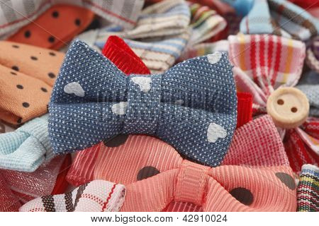 Bow ties and hair bows pile