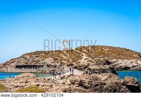 Naxos, Greece - July 23 2016: View Of Palatia Hill With The Portara Doorway On Top. Portara Is The R