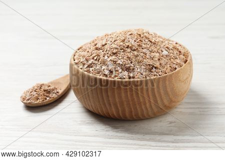 Bowl Of Wheat Bran On White Wooden Table