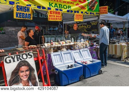 New York-august 6: A Street Festival Shish Kabob Stand Taking Orders And Cooking On August 6  2021 I