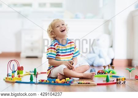 Kids Play With Wooden Railway. Child With Toy Train. Educational Toys For Young Children. Little Boy