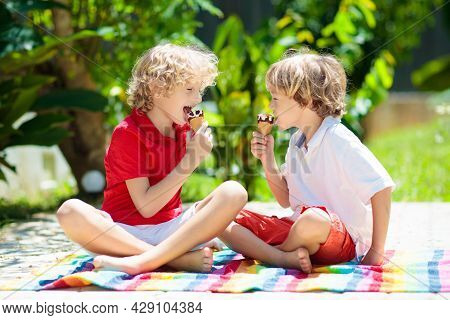 Kids Eat Ice Cream In Garden. Summer Fun.