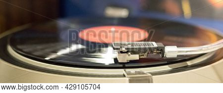 Vinyl Record Player, Bright Lights Disco-bokeh. Needle On Vinyl Record. Playing A Vinyl Record.