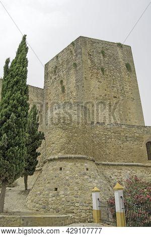 Tower Of The Castillo De Santiago In Sanlucar De Barrameda, Cadiz, Andalusia, Spain. Vertically