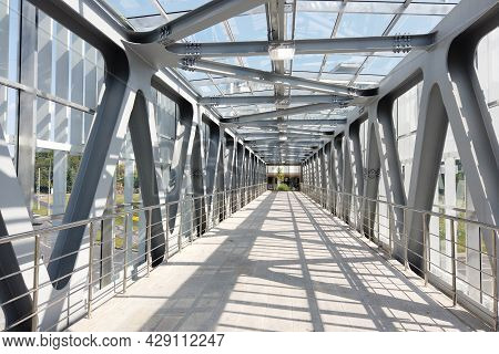 Glass Pedestrian Bridge With Metal Beams Inside. Perspective Perspective. Inside View.