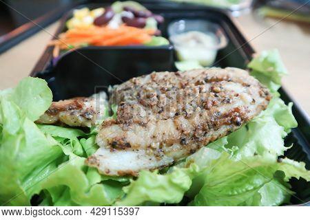 Grilled Fish , Fish Steak Or Striped Catfish Steak In The Box