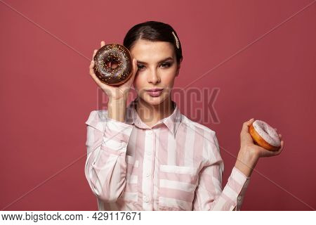 Beauty Fashion Model Woman Taking Colorful Sweets Donuts. Diet, Dieting, Junk Food, Slimming And Wei