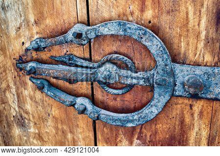 Vintage Door Metal Hinge In The Old Wooden Gate In Morocco.