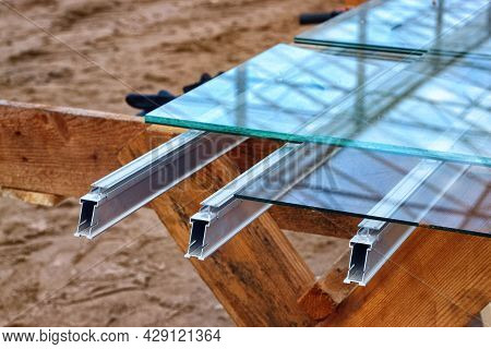 Cuts Of Glass On A Wooden Stand