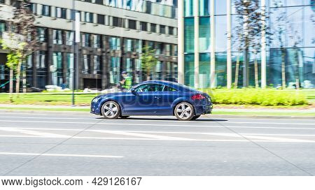 Blue Audi Tt Mk2 Is Driving On High Speed In Front Of Modern Buildings With Glass Facade. Moscow, Ru
