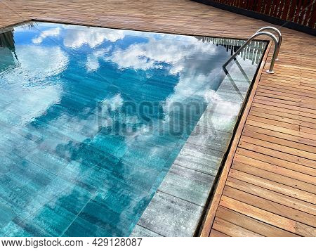 Rimless Pool, With The Exterior Surrounded By Teak Wood, Deep Blue Crystal Clear Water, Swimming Poo