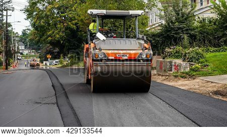 NORWALK, CT, USA - JULY 28, 2021: Heavy machinery from Grasso Companies is working on  road construction