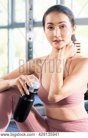 Beautiful Fitness Slim Fit Woman In Sportswear Sitting Take A Break On Fitness Machine In A Gym Fitn