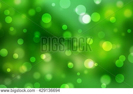 Abstract Green Yellow Bokeh Background With Soft Light Shiny And Glitter Natural Color. Texture Summ