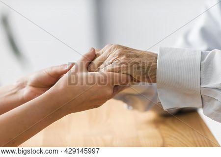 Nurse Holding Senior Man S Hands Comfort. High Quality Beautiful Photo Concept