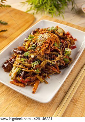 Close Up Of Pork Stir Fried With Noodles And Vegetables
