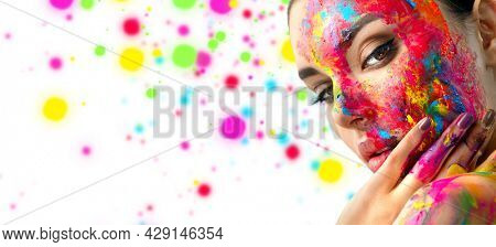Fashion Model Girl colorful face paint. Beauty fashion art portrait, beautiful woman with painting smears, abstract makeup. Vivid paint make-up, bright colors. Multicolor creative make-up. Painter