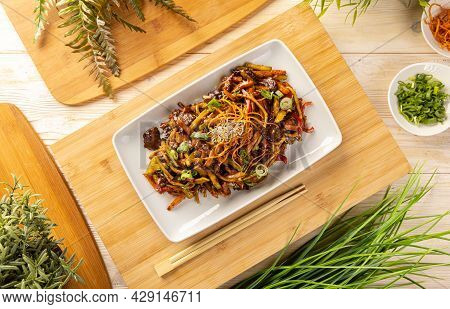 Flat Lay Of Pork Stir Fried With Noodles And Vegetables