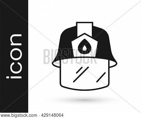 Black Firefighter Helmet Or Fireman Hat Icon Isolated On White Background. Vector