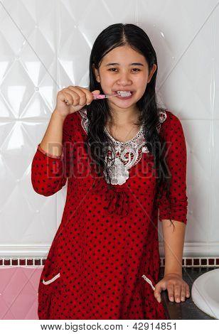 Cute Asian-thai Girl Brushing Her Teeth
