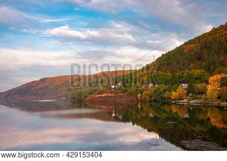 Mountain Lake Somesul Cald At Sunset. Beautiful Autumnal Countryside Landscape Of Cluj Country, Roma
