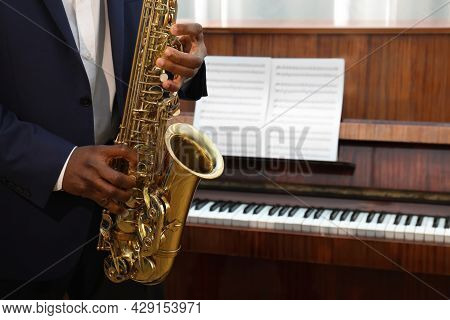 African-american Man Playing Saxophone Indoors, Closeup With Space For Text. Talented Musician