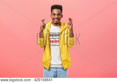 Portrait Of Hopeful Optimistic Handsome African American Man With Beard And Curly Haircut Crossing F