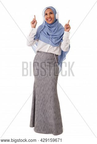 Music And Technology Concept-full Length Of Happy Asian Muslim Woman Enjoing Using Headphone To List