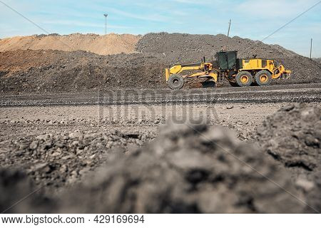 Motor Graders Road Construction. Industrial Machine On Construction Of Roads. Tractor Moving On Dirt