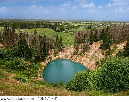 Aerial View On Bluff Sides Of Karst Lake Sea Eye Or Morskoy Glaz, And Spruce Forest Surrounding It,
