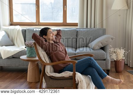 Calm Indian Woman Rest In Chair Daydreaming