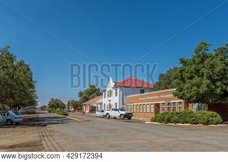 Rouxville, South Africa - April 23, 2021: A Street Scene, With Buildings And Vehicles, In Rouxville