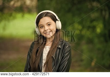 Enjoy Sound Music. Happy Child Listen To Sound Track In Park. Small Girl Enjoy Music Playing In Earp