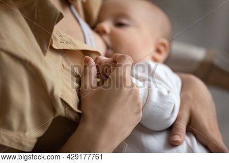 Close Up Of Mom Breastfeed Baby Infant