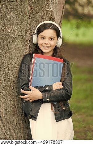 Audio Lesson. Happy Kid Listen To Audio File At Tree. Little Child Wear Audio Headphones. Listening