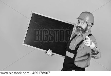 Professional Skills. Builder Man Smile At Flipchart. Engineer Project, Copy Space. Architect And Eng