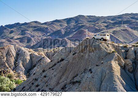 Tabernas, Spain - Nov 29, 2019: Suv Vehicle On Desert Landscape With Dunes And Sand. Adventure Road