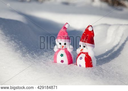 Little Snowmen In The Snow In Sunny Weather.