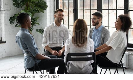 Smiling Diverse People Engaged In Group Counseling Together