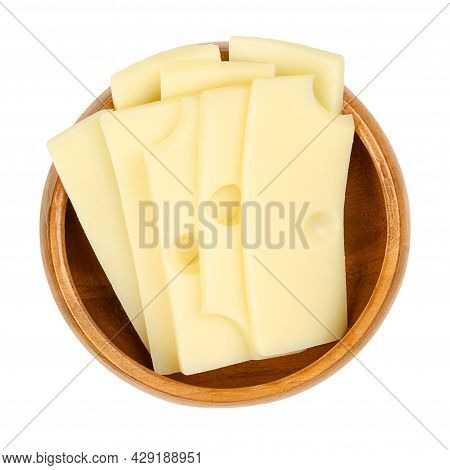 Sliced Emmental Cheese, In A Wooden Bowl. Slices Of Emmenthal Or Emmentaler, A Yellow Swiss Cheese W
