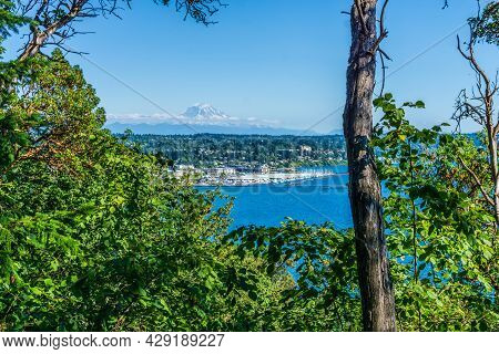 A View Of The Marina In Des Moines, Washington With Mount Rainier In The Distance.